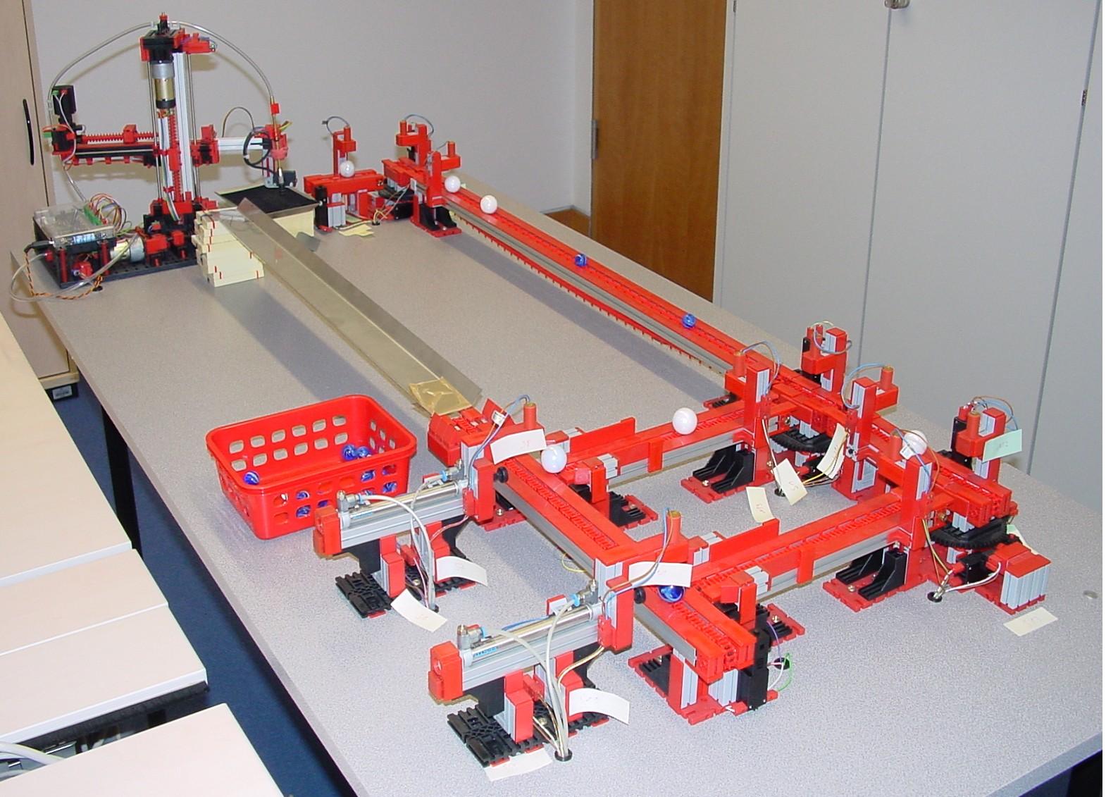 a miniature production line built with Fischertechnik